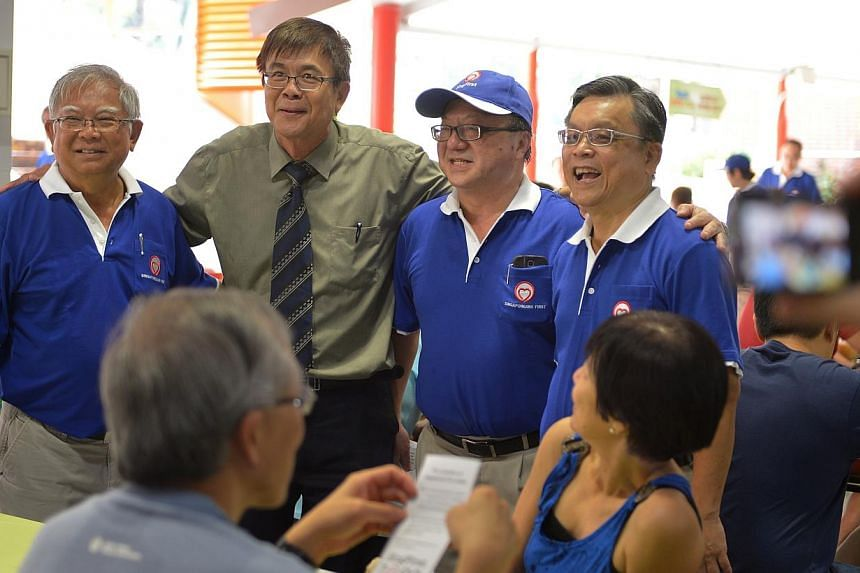 More than 20 members and supporters joined Singaporeans First (SingFirst) on Sunday morning as the new political party held its debut walkabout in Tanjong Pagar GRC, a stronghold of the ruling People's Action Party (PAP). -- ST PHOTO: CAROLINE C