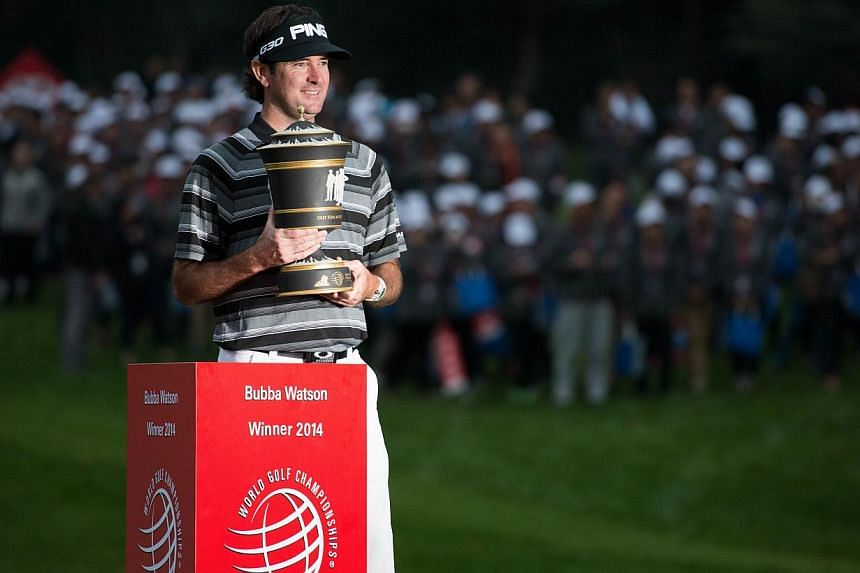 Bubba Watson of the US poses with his trophy after winning the WGC-HSBC Champions Golf tournament in Shanghai on Nov 9, 2014. -- PHOTO: AFP