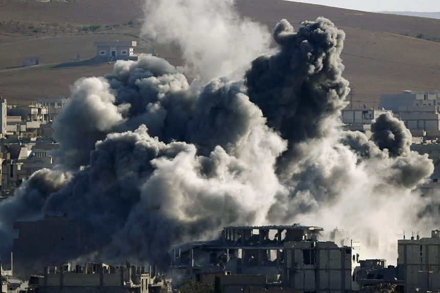 An explosion following an air strike is seen in central Kobane on Nov 9, 2014.More than 1,000 people, mostly extremists, have been killed in Kobane since the Islamic State in Iraq and Syria (ISIS) launched an offensive on the Syrian border town