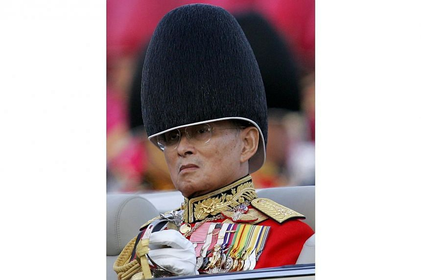 This file picture taken on Dec 2, 2007, shows Thai King Bhumibol Adulyadej reviewing an honor guard as a part of the celebration to commemorate his 80th birthday at the Royal Plaza in Bangkok.Thailand's revered King Bhumibol Adulyadej, the worl