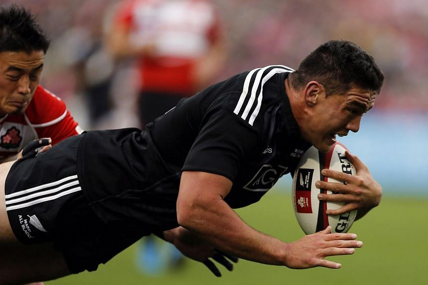New Zealand's Maori All Blacks' Codie Taylor (right) is tackled by Japan's Ayumu Goromaru as he dives to score a try during their international rugby test match in Tokyo on Nov 8, 2014.The highly-anticipated match between New Zealand's Maori Al