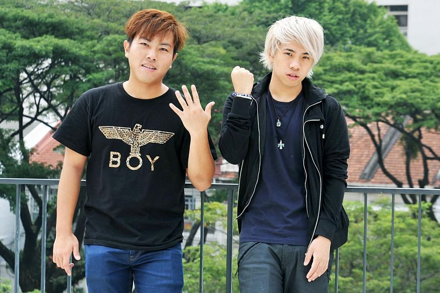 Tan Jian Hao (right), a Singaporean YouTube star, on returning home after studying at an international school overseas. He will work with producer Shawn Tan (left) on the short film on Singlish. -- ST PHOTO: RUDY WONG