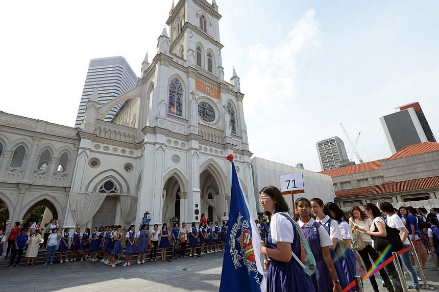 CHIJ students and alumni celebrating the schools' 160th anniversary by attempting to establish a Guiness record for a human chain of girls around Chijmes while singing the school song. A fund to help needy students was also launched at the event. --