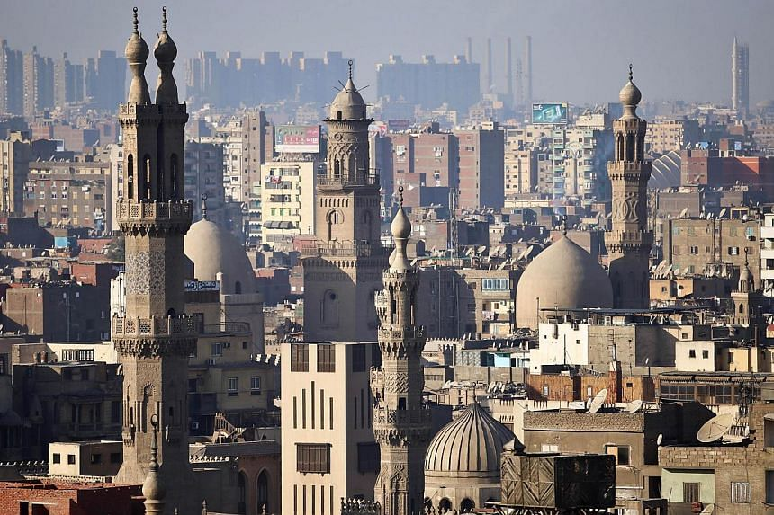 The minaret's of mosques are pictured in Cairo on Nov 8, 2014. Egypt on Saturday announced the arrest of a US-Egyptian citizen accused of having posted on Islamic militant websites a threat to attack American and other international schools in the re