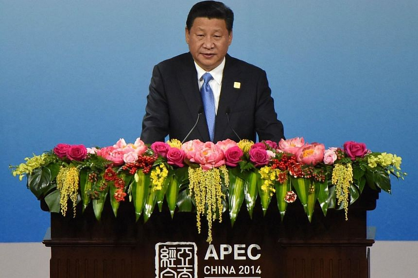 China's President Xi Jinping speaking to open the Apec CEO Summit at the China National Convention Centre (CNCC) in Beijing on Nov 9, 2014, part of the Asia-Pacific Economic Cooperation (Apec) Summit. Top leaders and ministers of the 21-member Apec g