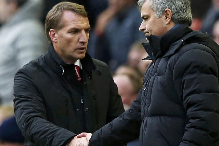 Chelsea manager Jose Mourinho (right) and Liverpool manager Brendan Rodgers shake hands at the end of their English Premier League soccer match at Anfield in Liverpool, northern England, Nov 8, 2014. -- PHOTO: REUTERS