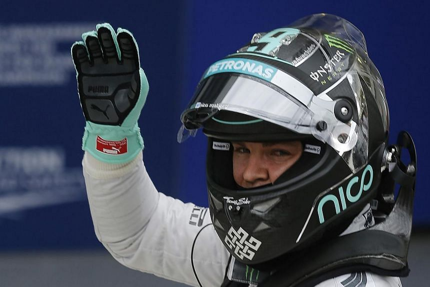 Mercedes Formula One driver Nico Rosberg of Germany waves after completing the qualifying session of the Brazilian Grand Prix in Sao Paulo Nov 8, 2014. Rosberg will start Sunday's Brazilian Grand Prix in Sao Paulo in pole position ahead of championsh