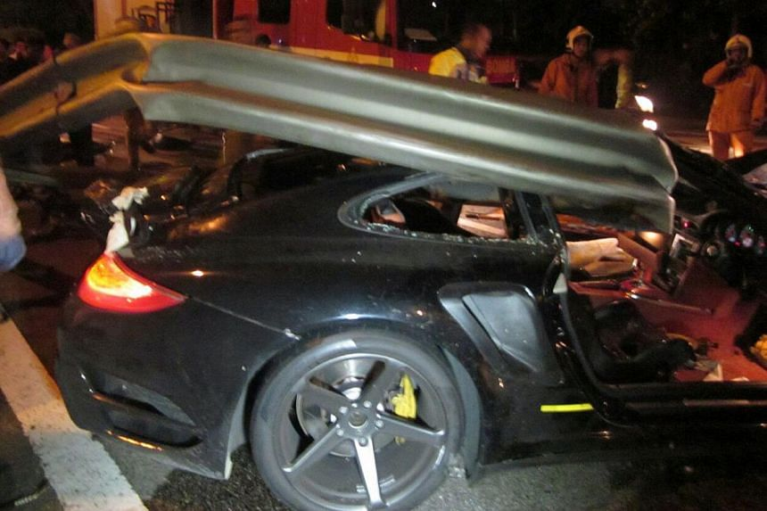 Two Singaporeans were killed after they lost control of their Porsche 911 Turbo, which crashed into the road divider of the KL-Seremban Expressway in Desa Petaling, Sunday morning. -- PHOTO: CHINA PRESS