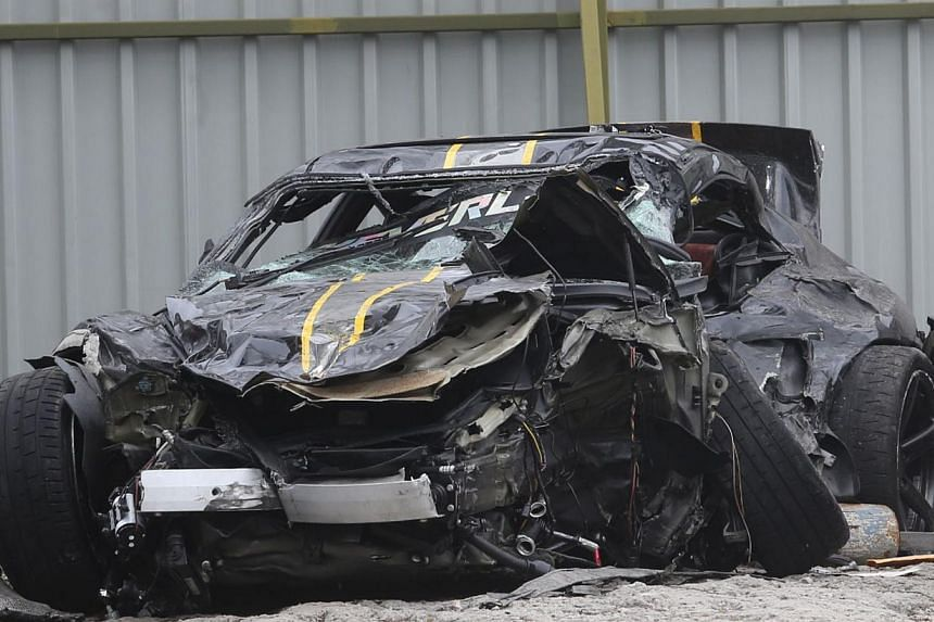 Two Singaporeans were killed after they lost control of their Porsche 911 Turbo, which crashed into the road divider of the KL-Seremban Expressway in Desa Petaling, Sunday morning. -- PHOTO: SIN CHEW DAILY PUBLICATION