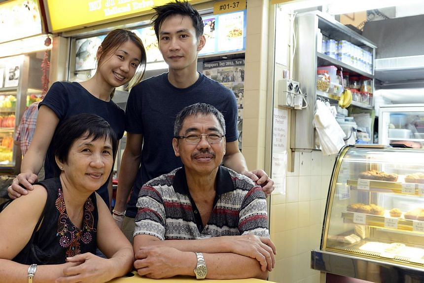 Husband and wife Daniel Lee and Joanne Ng, with Ms Ng's parents Mr Ng Hock Loo, and Madam Lim Hua Choon. The young couple runs Ru Ji Kitchen in Old Airport Road while Mr Ng owns a fishball noodle shop of the same name in Holland Drive. -- ST PHOTO: