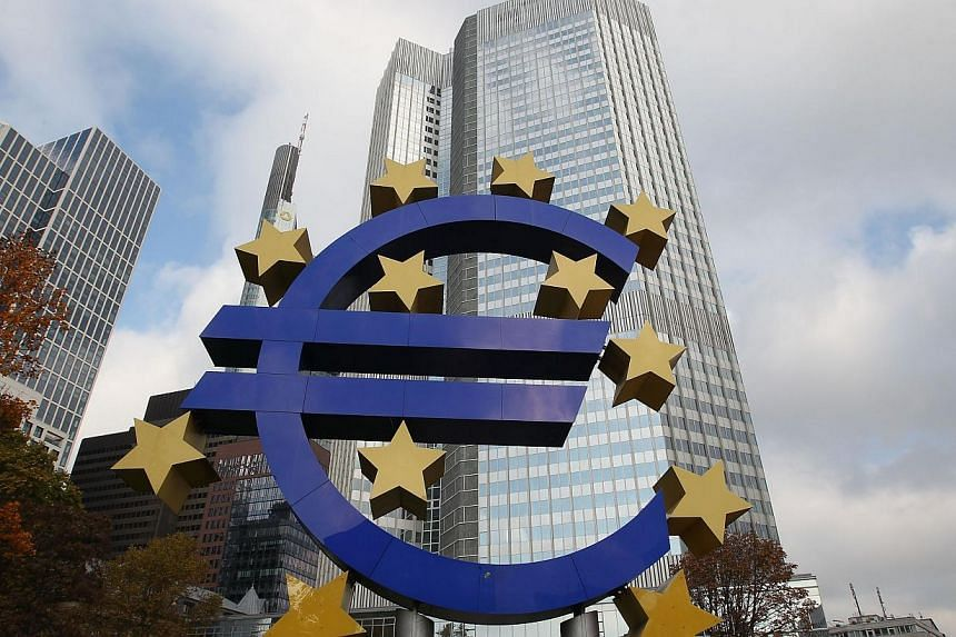 The Euro Zone logo located in front of the European Central Bank in Frankfurt, Germany. -- PHOTO: AFP