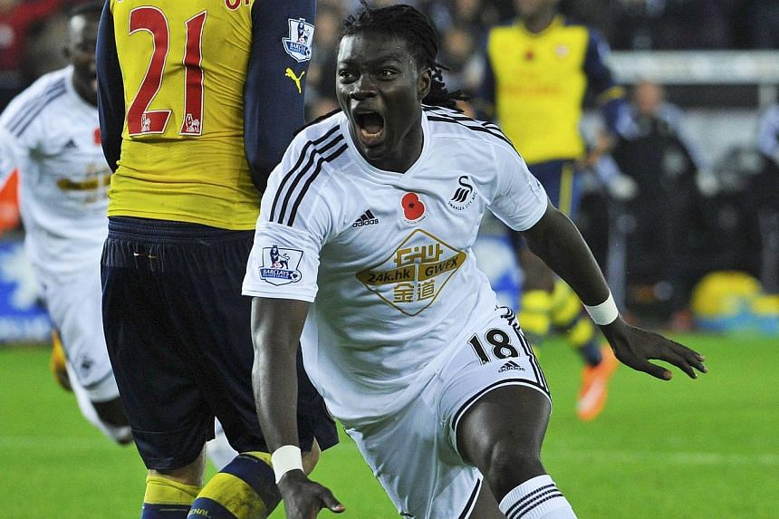Swansea's Bafetimbi Gomis celebrates his goal during their English Premier League match against Arsenal at the Liberty Stadium in Swansea, Wales, on Nov 9, 2014. -- PHOTO: REUTERS