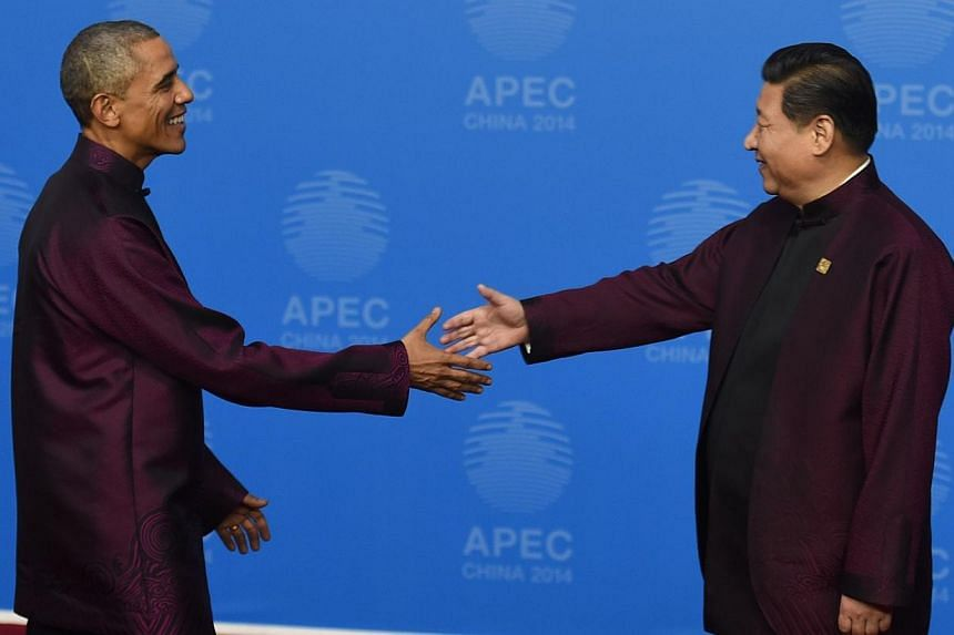 Finally, in this picture, US President Barack Obama is welcomed by Chinese President Xi Jinping as he arrives for the Asia-Pacific Economic Cooperation (Apec) Summit banquet at the National Aquatics Center in the Chinese capital on Nov 10, 2014. -- P