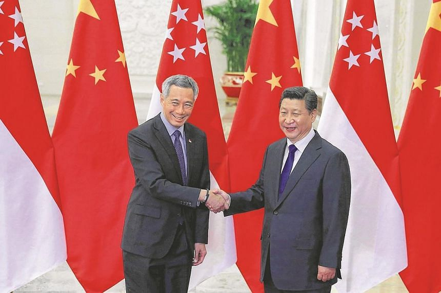Here is Singapore's Prime Minister Lee Hsien Loong (left) meeting with China President Xi Jinping at the Great Hall of the People in Beijing, on the sidelines of the Asia-Pacific Economic Cooperation (Apec) meetings, Nov 9, 2014. -- PHOTO: REUTERS