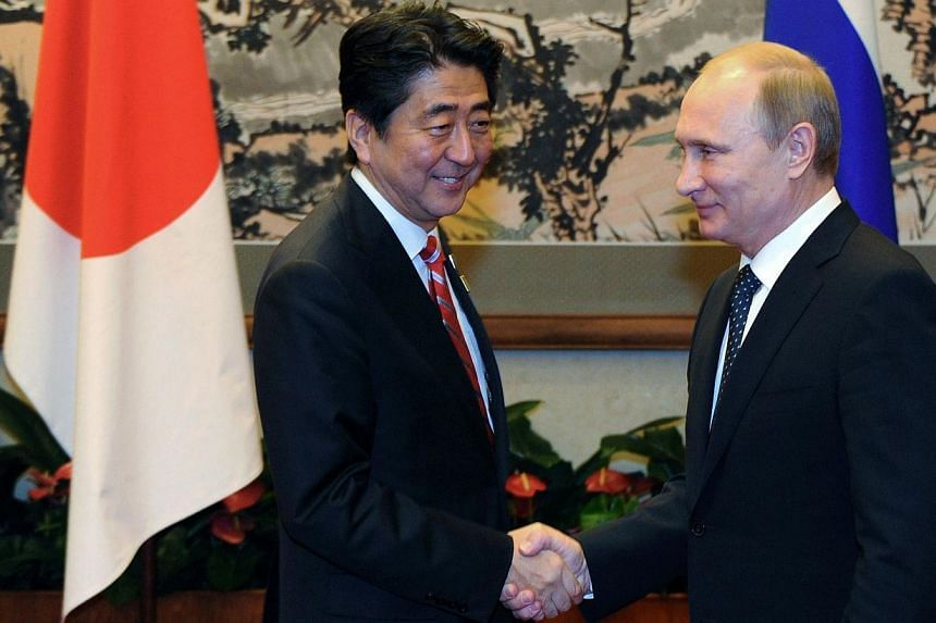 Likewise, this is Russian President Vladimir Putin (right) shaking hands with Japanese Prime Minister Shinzo Abe during their meeting at the Asia-Pacific Economic Cooperation (Apec) summit in Beijing on Nov 9, 2014. -- PHOTO: AFP