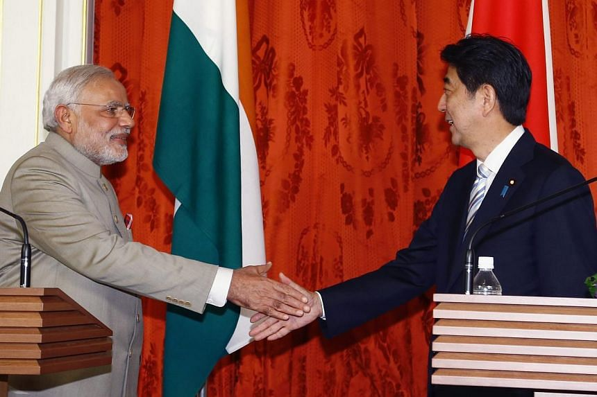 Now let's see how both are, when they meet other leaders instead. This is India's Prime Minister Narendra Modi (left) shaking hands with Japan's Prime Minister Shinzo Abe at the end of their joint news conference at the state guest house in Tokyo on