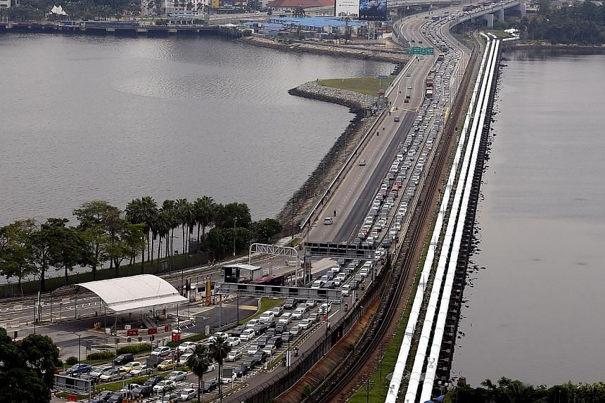 Malaysia's government revealed that 1.5 million paying vehicles crossed the Causeway in August after a toll-hike that has begun to hit Johor's economy.-- PHOTO: ST FILE