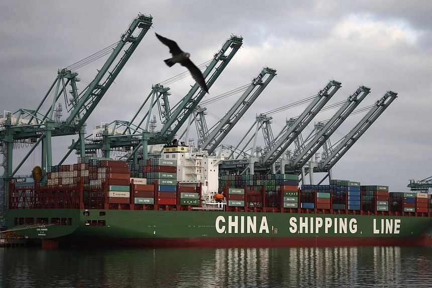 A container ship belonging to China Shipping Container Lines at the Port of Los Angeles in San Pedro, California on Aug 20, 2014. China and the United States have agreed to significantly extend the terms of short-term visas in a bid to improve t