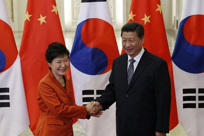 China's President Xi Jinping (right) shakes hands with South Korea's President Park Geun Hye at the Great Hall of the People on the sidelines of the Asia-Pacific Economic Cooperation (Apec) Summit in Beijing on Nov 10, 2014. -- PHOTO: AFP