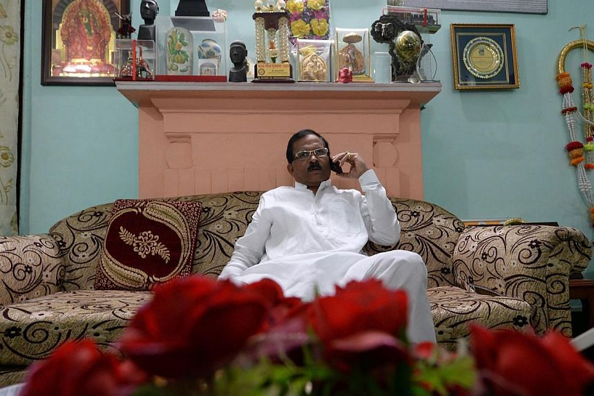 Indian Prime Minister Narendra Modi has appointeda yoga minister, MrShripad Yesso Naik, as part of a major revamp of his government after storming to power in May. -- PHOTO: AFP
