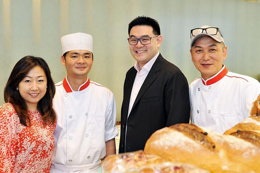 New partnership: (from left) Asanoya's chief executive officer Maki Asano, head baker Kenny Wong, Tan Chong International's executive director Glenn Tan and Asanoya's Japanese chef and consultant Naomichi Kobayashi. -- ST PHOTO: RUDY WONG