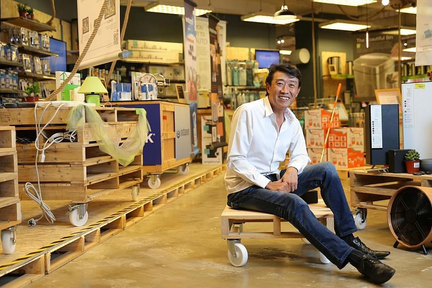 Home-Fix founder Low Cheong Kee started out as a one-man show and with his ability to adapt and transform, his business grew and grew. -- ST PHOTO: ONG WEE JIN