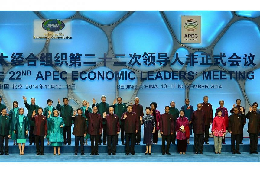 "The leaders of the Asia-Pacific Economic Cooperation (Apec) posing for a ""family photo"" at the Beijing National Aquatics Center in the Chinese capital on Nov 10, 2014. -- PHOTO: AFP"