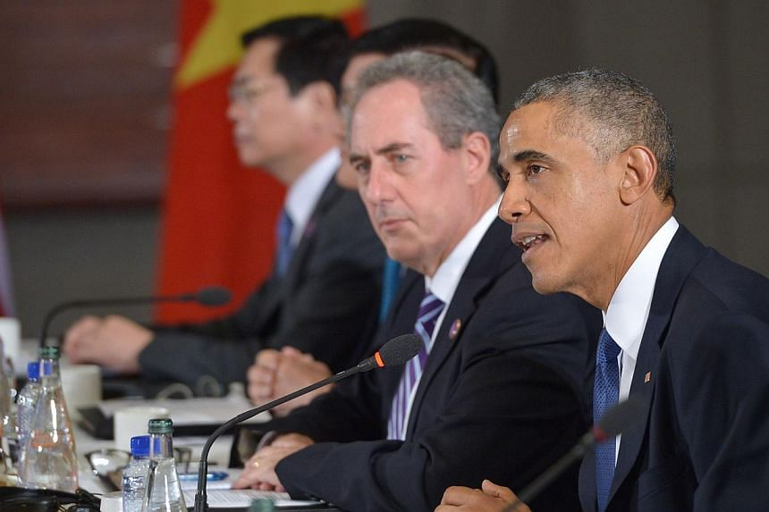 US President Barack Obama (right) speaks during a meeting with leaders from the Trans-Pacific Partnership at the US Embassy in Beijing on Nov 10, 2014, in Beijing. MrObama said on Monday that he sees momentum building for a Washington-backed fr