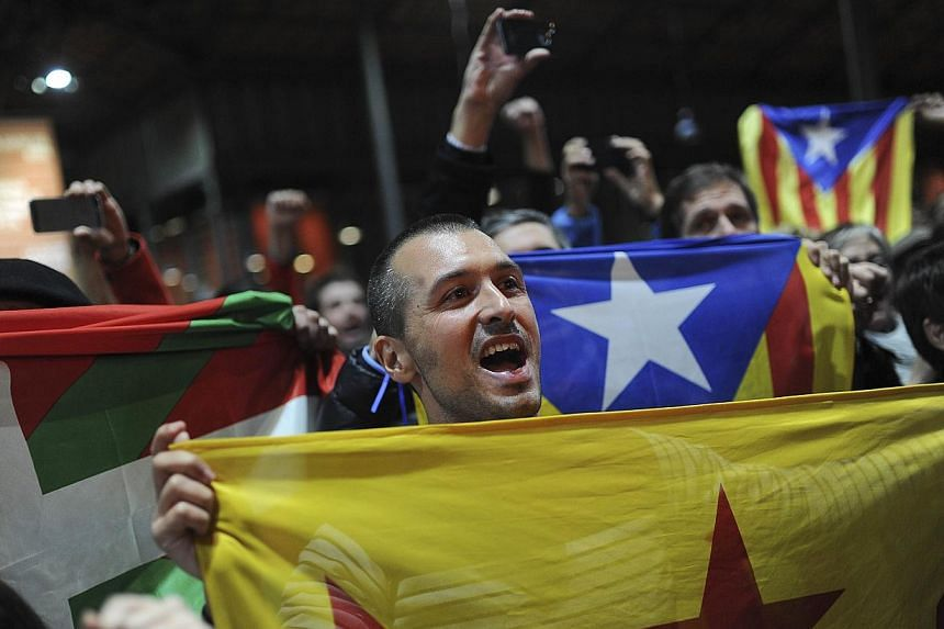 Pro-independence people hold a Catalan independence flag during a meeting organised by the Catalonia National Assembly (ANC) and the Omnium Cultural civil society association in Barcelona on Nov 9, 2014. Catalonia's nationalist government vowed