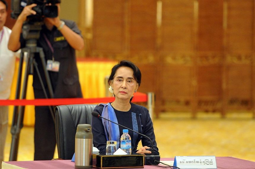 Aung San Suu Kyi, chairman of National League for Democracy (NLD) and lower house member of Parliament at a meeting with Myanmar President Thein Sein (not pictured) last month as he opened unprecedented talks with army top brass and political rivals