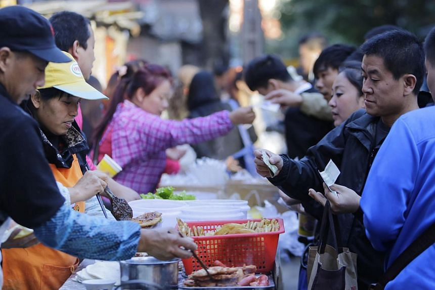 China's annual consumer inflation remained at a near five-year low in Oct 2014 at 1.6 per cent, showing proof that the world's second-largest economy is cooling and giving room to policymakers to stimulate growth if needed. -- PHOTO: REUTERS