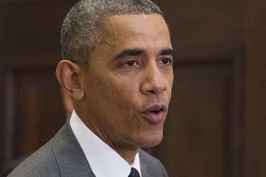 """US President Barack Obama said on Sunday that sending more troops to Iraq signals a """"new phase"""" in the fight against the Islamic State in Iraq and Syria (ISIS), amid unconfirmed reports that its leader has been wounded. -- PHOTO: AFP"""