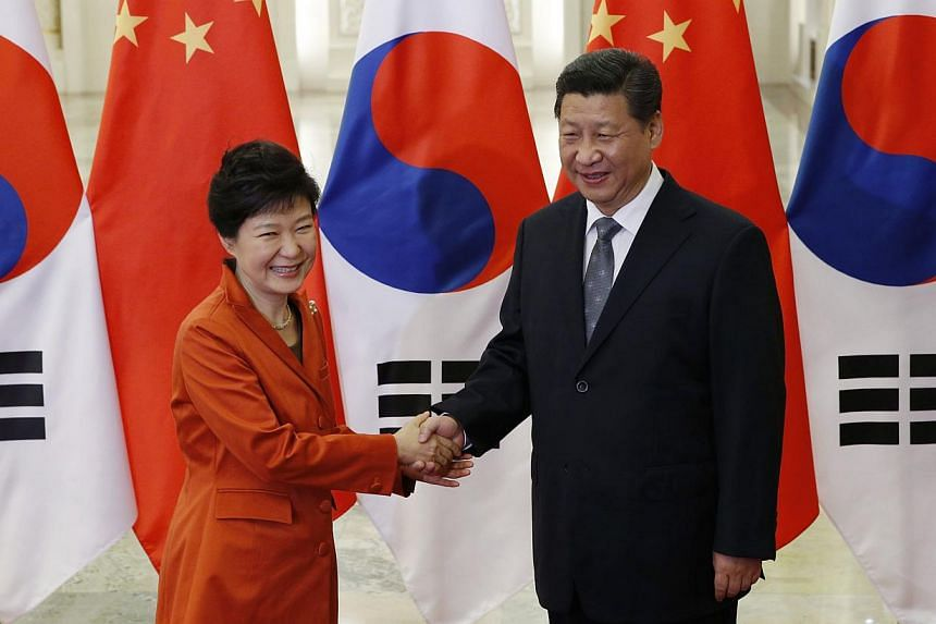 China's President Xi Jinping (right) with South Korea's President Park Geun Hye during a meeting at the Great Hall of the People, on the sidelines of the Apec meetings, in Beijing, on Nov 10, 2014. -- PHOTO: REUTERS