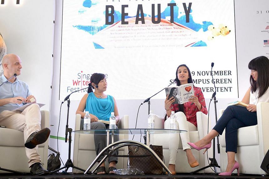 Singapore Writers Festival panel discussion Writing For The Global Audience, featuring (from right) Kirstin Chen, Ira Trivedi andAdeline Foo and moderated by Phil Tatham (left) on Nov 9, 2014. -- ST PHOTO:LIM SIN THAI