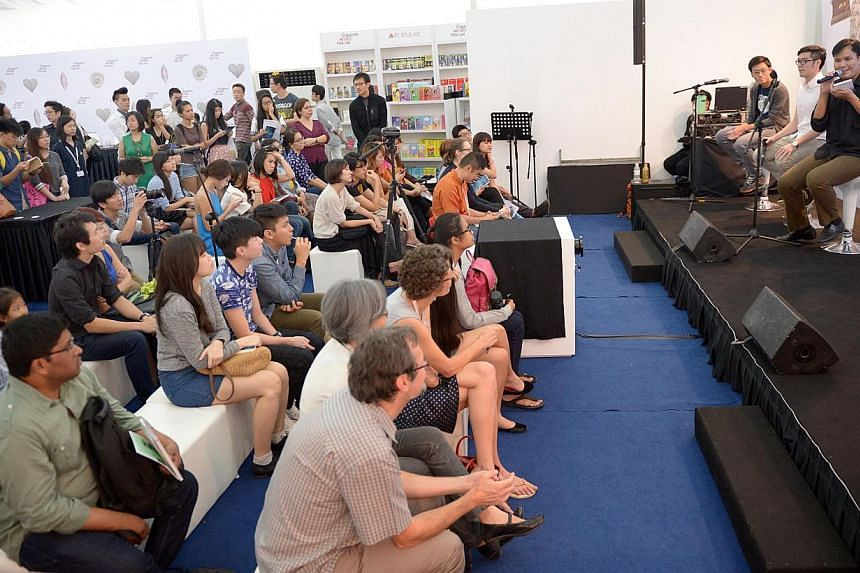 Poem readings by local university students/graduates at the Singapore Writers Festival on Nov 9, 2014.-- ST PHOTO:LIM SIN THAI