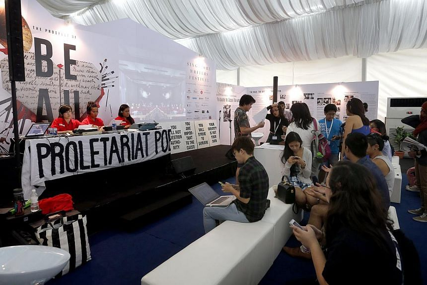Members of local poetry collective Proletariat Poetry Factory at the Singapore Writers Festival.-- ST PHOTO:CHEW SENG KIM