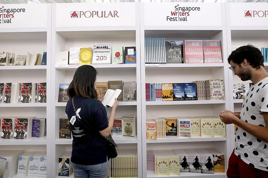 People browsing at the Singapore Writers Festival white tentage.-- ST PHOTO:CHEW SENG KIM