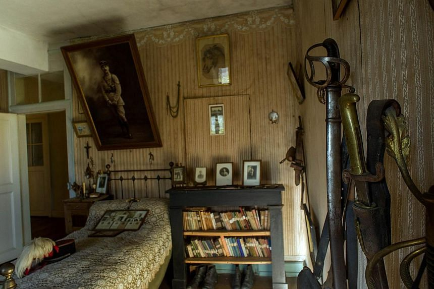 A picture taken on Oct 29, 2014 in Belabre, central France, shows swords and other belongings of French Word War I second lieutenant Hubert Rochereau, in his bedroom left intact since his death on the Belgian front. -- PHOTO: AFP