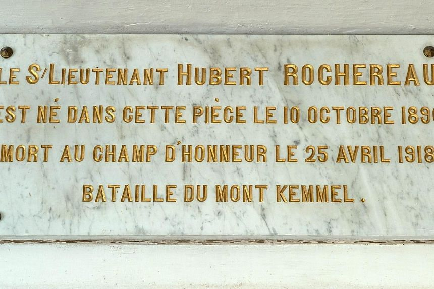 """A picture taken on Oct 29, 2014 in Belabre, central France, shows a plaque reading """"second lieutenant Hubert Rochereau was born in this room on Oct 10, 1896, died on the battlefield on April 25, 1918, Battle of Mount Kemmel"""" in the bedroom of French"""