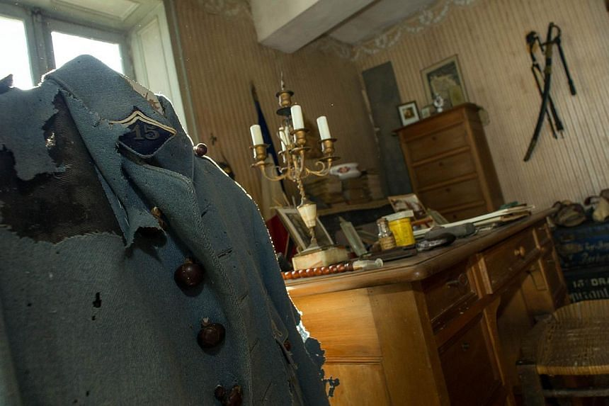 A picture taken on Oct 29, 2014 in Belabre, central France, shows the uniform which belonged to French Word War I second lieutenant Hubert Rochereau, in his bedroom left intact since his death on the Belgian front. -- PHOTO:AFP