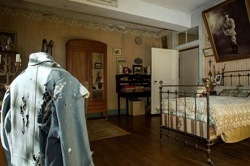 A picture taken on Oct 29, 2014 in Belabre, central France, shows the uniform which belonged to French Word War I second lieutenant Hubert Rochereau, in his bedroom left intact since his death on the Belgian front. -- PHOTO: AFP