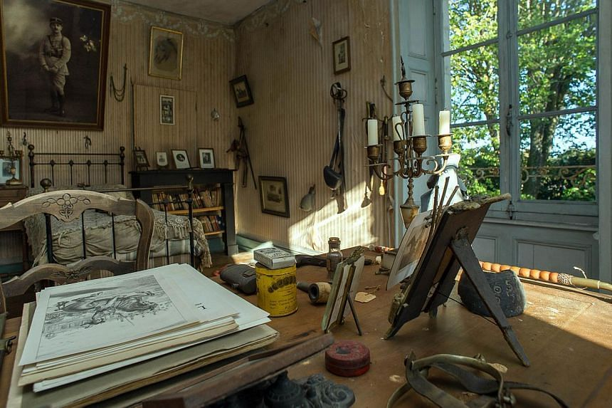 A picture taken on Oct 29, 2014 in Belabre, central France, shows the bedroom of French Word War I second lieutenant Hubert Rochereau, left intact since his death on the Belgian front. -- PHOTO: AFP