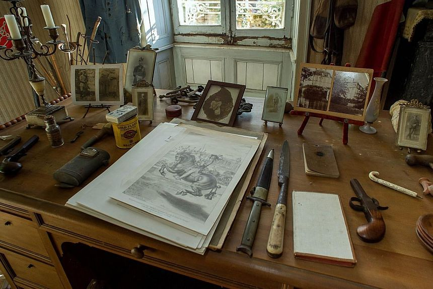 A picture taken on Oct 29, 2014 in Belabre, central France, shows the desk and belongings of French Word War I second lieutenant Hubert Rochereau, in his bedroom left intact since his death on the Belgian front. -- PHOTO: AFP