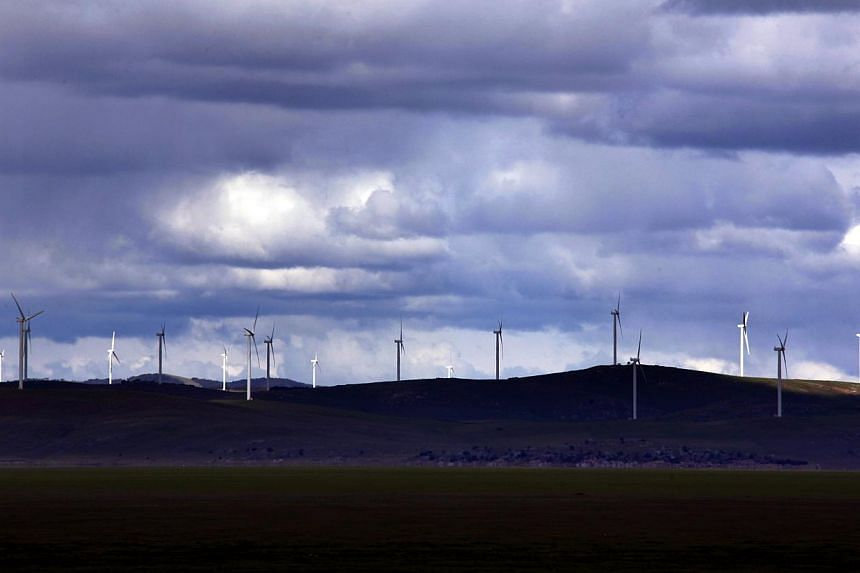 Wind turbines at the Infigen Energy wind farm at Lake George,  on the outskirts of Canberra. Australia is falling behind China and the United States in tackling climate change, according to a study. -- PHOTO: REUTERS