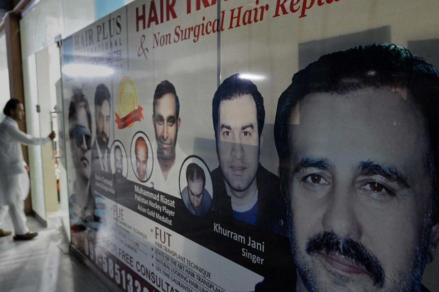 A hair transplant clinic in Peshawar. In the north-western city, home to underground Taleban hideouts and a gateway for trade to Afghanistan, men go about their business in the crowded dusty streets, their faces covered by bushy black beards that wou