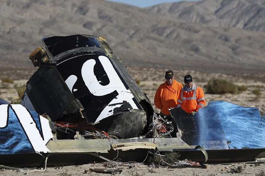 Sheriffs' deputies look at wreckage from the crash of Virgin Galactic's SpaceShipTwo near Cantil, California on Nov 2, 2014. -- PHOTO: REUTERS