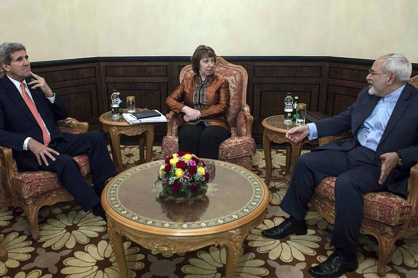 US Secretary of State John Kerry (left), EU envoy Catherine Ashton (centre) and Iranian Foreign Minister Mohammad Javad Zarif meet in Muscat on November 10, 2014. -- PHOTO: REUTERS