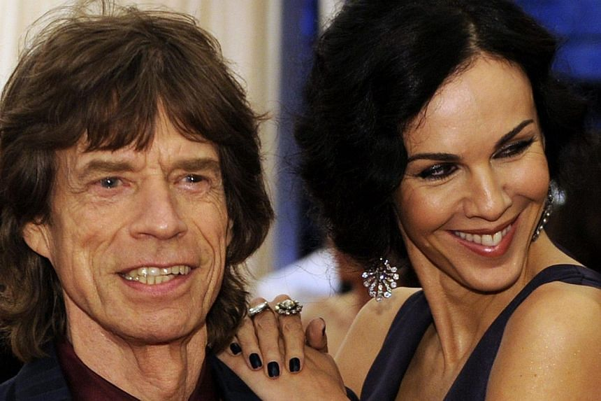In this May 7, 2012 file photo, musician Mick Jagger and L'Wren Scott attend the Costume Institute Benefit at The Metropolitan Museum of Art in New York. -- PHOTO: AFP