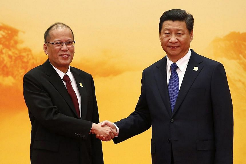 Philippine President Benigno Aquino (left) shakes hands with China's President Xi Jinping during a welcoming ceremony at the Asia Pacific Economic Cooperation (APEC) forum, at the International Convention Center at Yanqi Lake, in Huairou district of