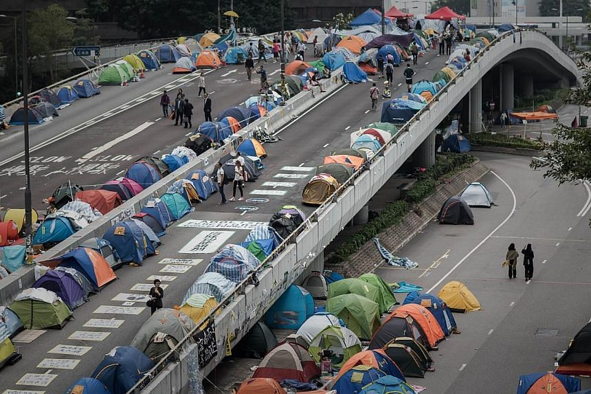 A pro-democracy protest site set up on a highway in the Admiralty district of Hong Kong on Nov 11, 2014. The weeks-long mass democracy protests had influenced the survey, said the head of the Chinese University of Hong Kong's journalism school, which